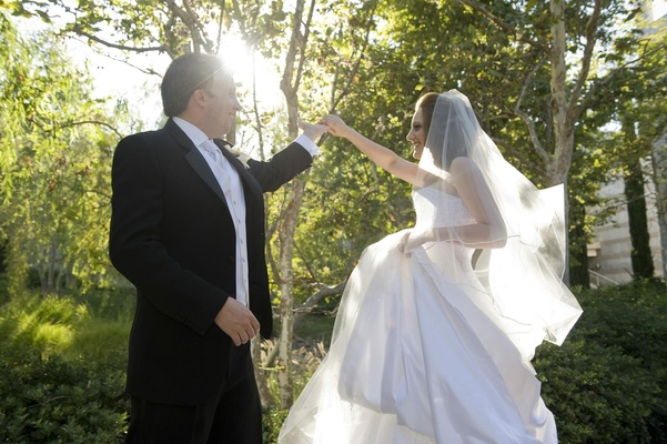 Groom spins bride during popular first look tradition