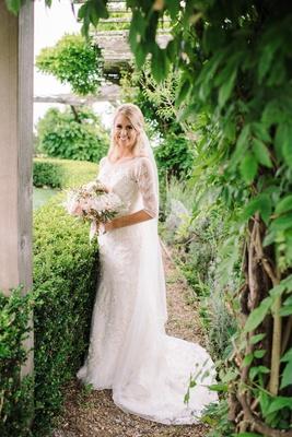 Bride Wearing Oleg Cassini Wedding Dress With Lace Three Quarter Sleeves