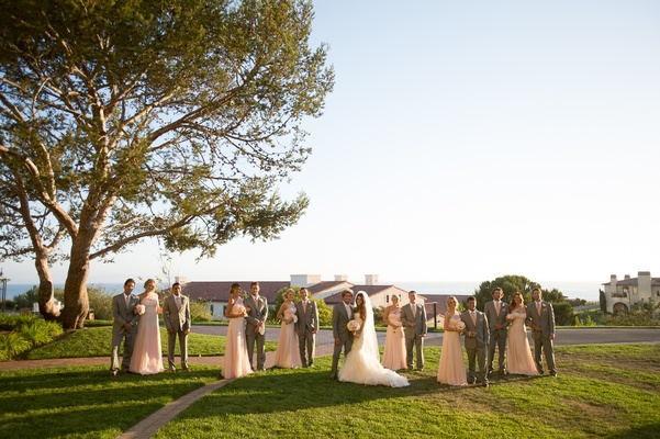 Grey groomsmen suits and pink bridesmaid dresses