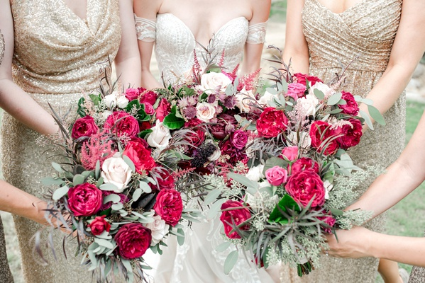 bridesmaids in sequin gold, bouquets in deep magenta and pink, feminine fall wedding colors