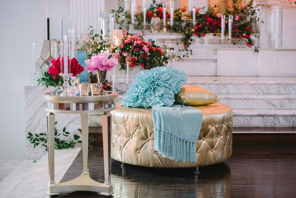 gold ottoman wedding reception lounge area pink blue details leaves