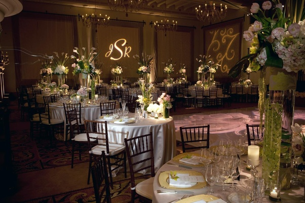 Reception room with classic tables and monogram on wall