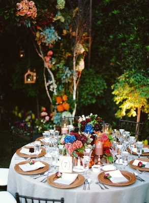 Round reception table with colorful flower centerpieces