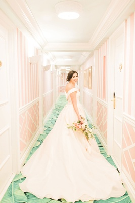 The Confused Millennial v back off shoulder blush ball gown wedding dress the colony hotel hallway