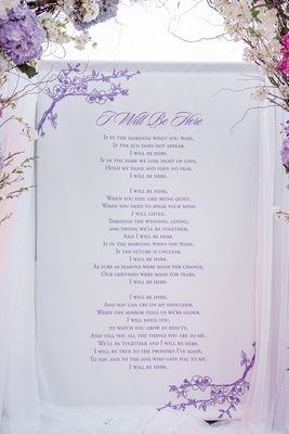 """i will be here"" love poem printed in purple behind altar"