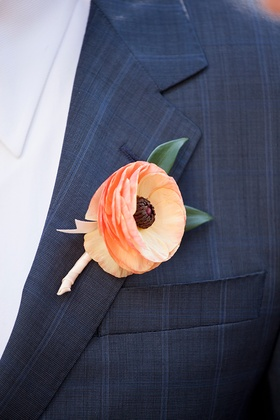 Groom in navy blue stripe suit with ranunculus flower boutonniere peach apricot orange