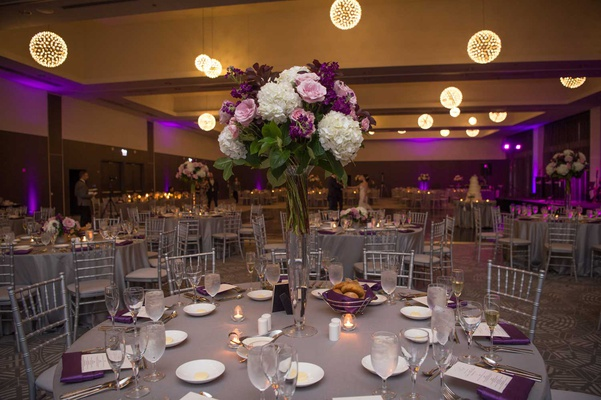 wedding reception tall centerpiece grey linen chandelier orb sphere pink white purple flowers purple