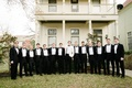 Groomsmen in tuxedos and groom in white jacket for new year's eve wedding in Texas