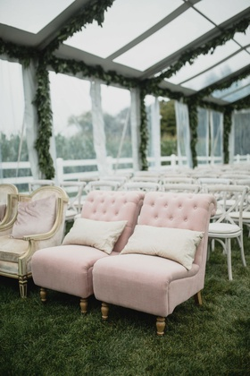 wedding guest seating tent wedding ceremony grass lawn clear tent pink slipper chair tufted antique
