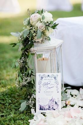 castle wedding ceremony program blue drawing of castle lantern decor pink white flowers