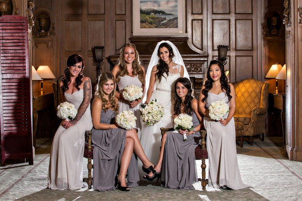 bridesmaids dressed in dark and light gray long dresses