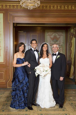 Navy mother of the bride dress with bride and groom