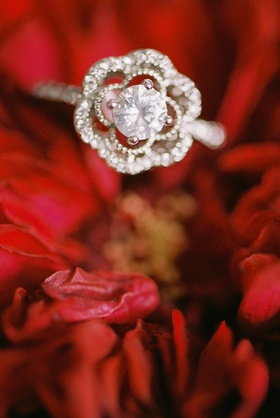beauty beast movie styled wedding shoot floral shaped engagement ring on red flowers unique jewelry