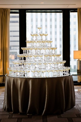 wedding reception city view chicago large mirror table coupe glass champagne tower