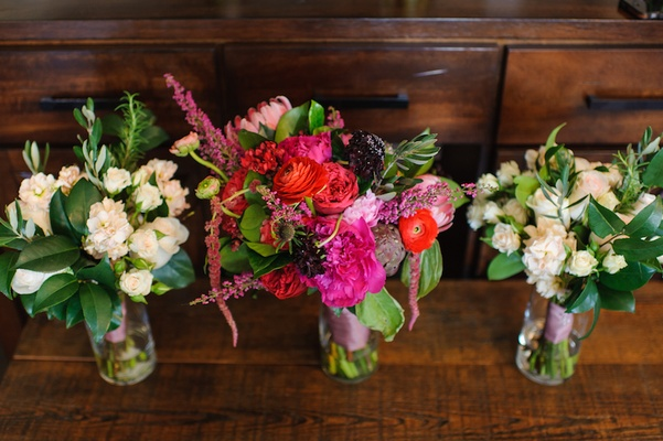 Vibrant bride bouquet and ivory bridesmaid flowers