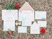 desert inspired invitation suite with watercolor cactus and gold calligraphy