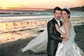 Bride in Baroque dress and groom on beach
