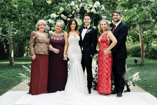Wedding of Jillian Murray and Dean Geyer family members in burgundy red dresses and ties to match