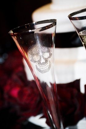Champagne flute with a silver rim and skull graphic