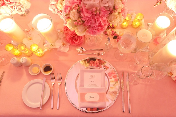 Silver mirror charger with pink flower centerpiece