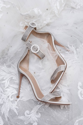 wedding shoes on veil silver high heels with metallic details strap at ankle and toe sandals