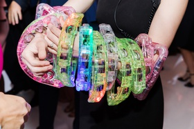 colorful plastic tambourines on dance floor during wedding reception