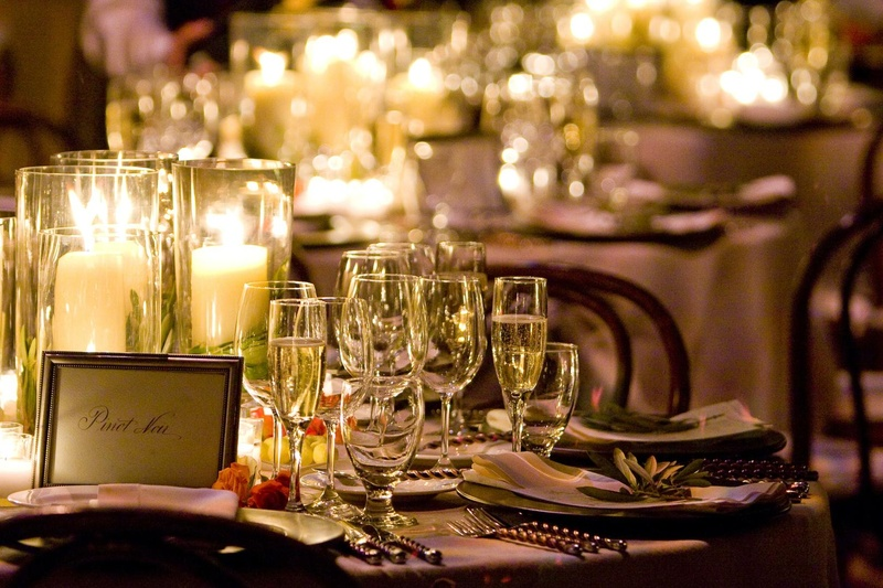 Vineyard wedding tablescape with candles and wine table name