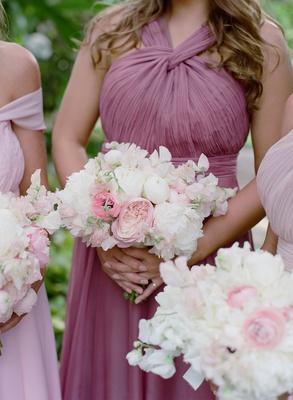 Bridesmaids in mismatched dresses purple pink lavender mauve necklines pink garden rose white peonie