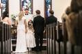bride in gregory ellenberg, groom in brooks brothers tuxedo, daughter in between during vows