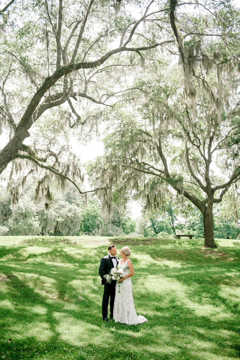 wedding portrait in wedding location grass lawn tall trees lowcountry south carolina destination