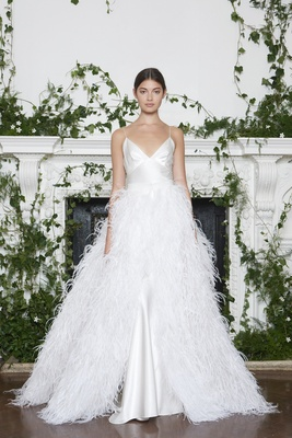 Monique Lhuillier Fall 2018 Silk white gown with spaghetti straps and feather overskirt