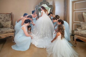 Echosmith singer Sydney Sierota with bridesmaids in light blue dresses and flower girl getting ready