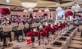 Elegant lace linens and crimson rose centerpieces
