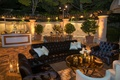 Lounge area outside velvet tufted furniture candles hurricane gold coffee table bar dessert station