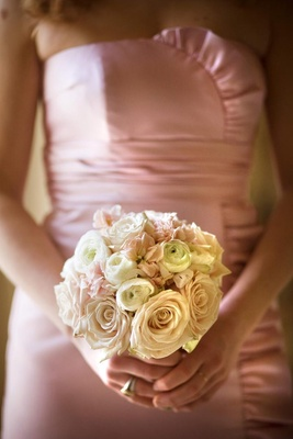 Pink and white roses and garden roses in small bouquet