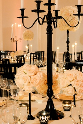 Black centerpieces with ivory rose decorations
