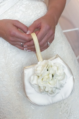 White satin bag with strap and flowers
