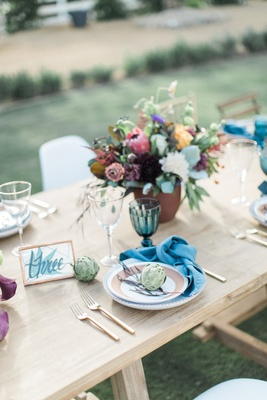 rustic blue tan place setting tablescape california winter wedding styled shoot ranch naked table