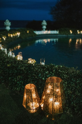 wedding reception decorated with lanterns hedge wall pond fountain statues newport rhode island
