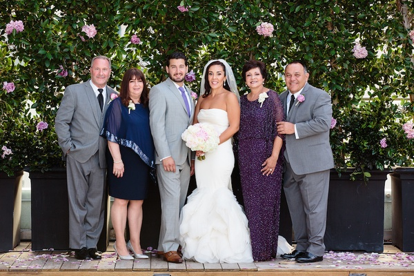 573e8aeb7e ... Bride in a Vera Wang dress with ruffled skirt, groom in grey suit and  purple; White wedding ...