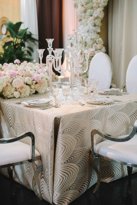 opulent wedding table design with crystal candelabra hydrangea, rose, peony, ranunculus