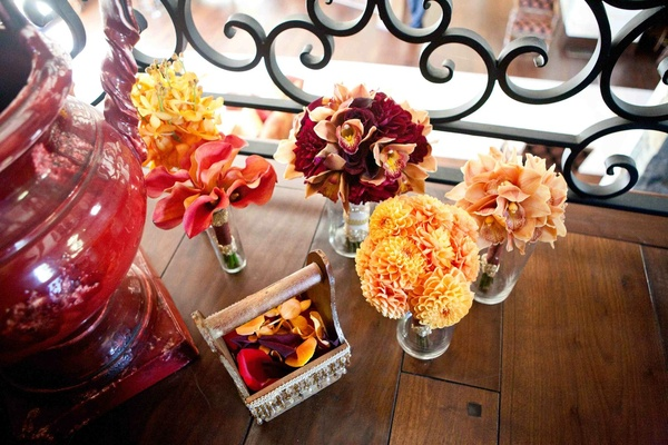 Bridesmaid's bouquets of orange and yellow flowers