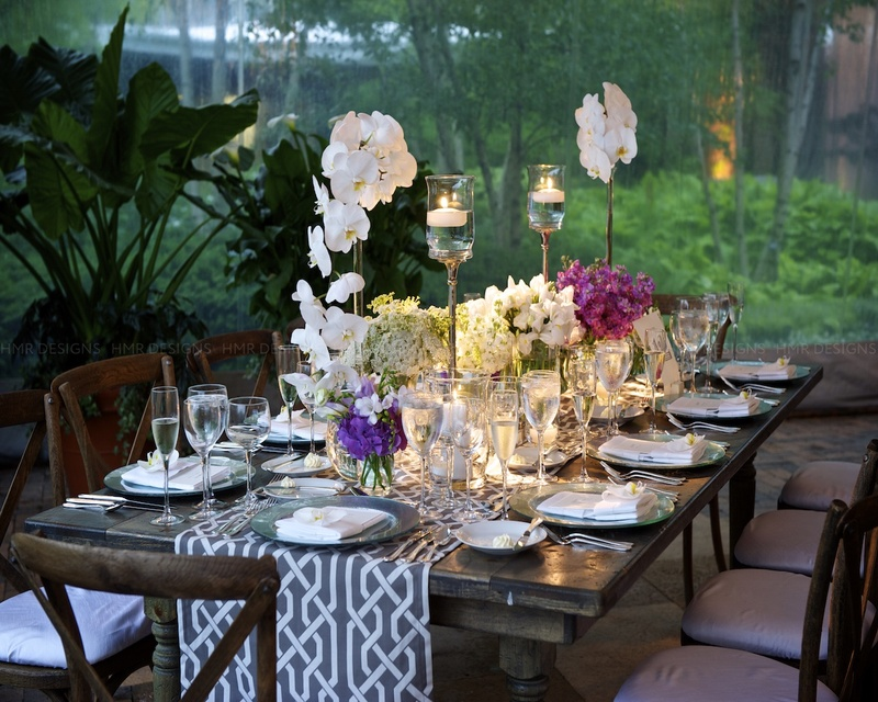 White, purple & pink floral brighten up a gray, rustic tablescape.