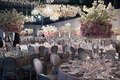 Wedding reception with silver chairs and pink linen tables round tall centerpieces pink flowers