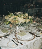 Reception table with luxurious linens and flowers