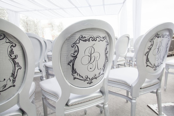 White round back chair silver cushions and backs snakeskin monogram on every guest seat same sex