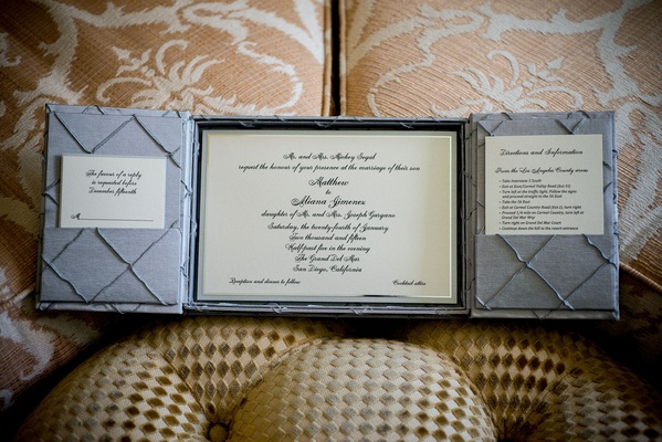 Wedding invitation inside box with grey panels and sophisticated calligraphy