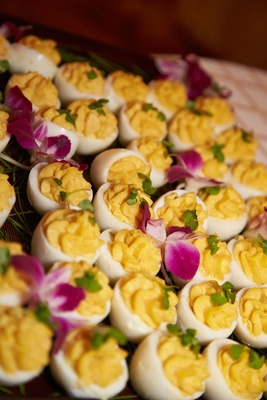 Wedding appetizers of The Ritz-Carlton deviled eggs, fuchsia orchids