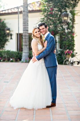 hummingbird nest ranch wedding bride in mira zwillinger wedding dress groom in blue suit yellow tie