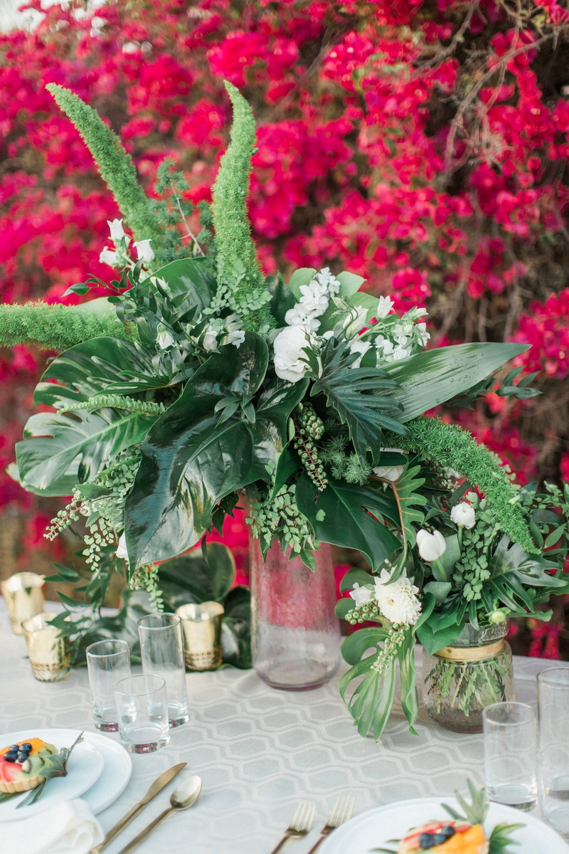 Rustic Floral Arrangement Of Greenery Maiden Hair Monstera Leaves Foliage Boho Table Wedding